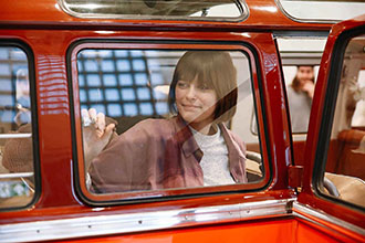 orange volkwagen T1 window and girl